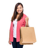 Happy girl with shopping bag. Isolated on white Stock Images