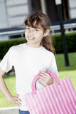 Happy girl with shopping bag. Outdoors Stock Images