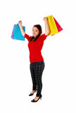 Happy girl with shopping bag's. A full body picture of a pretty teenager girl holding up her colour Royalty Free Stock Photo