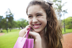 Happy girl with shopping bag. Smiling outdoors Stock Photography