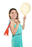 Happy girl shopping bag. Happy girl with shopping bag and yellow balloon Stock Images