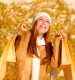 Happy girl with shopping bags Royalty Free Stock Photography