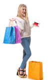 Happy girl with shopping bags and credit card Stock Photos