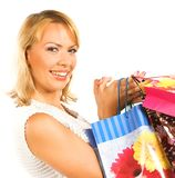 Happy girl with shopping bags. On white background Royalty Free Stock Image