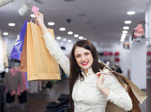 Happy girl with shopping bags. Portrait of happy girl with shopping bags Royalty Free Stock Image