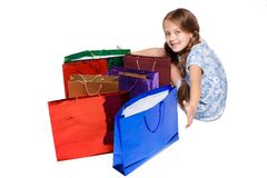 Happy girl with shopping bags sitting at studio Stock Photo