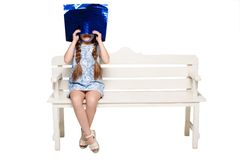 Happy girl with shopping bags sitting at studio Royalty Free Stock Images