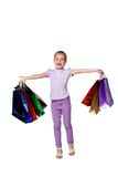 Happy girl with shopping bags standing at studio Stock Images
