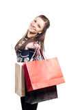 Happy Girl with shopping bags on white Royalty Free Stock Images