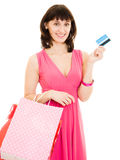 Happy girl with shopping and debit card Stock Photos