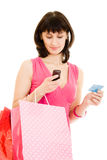 Happy girl with shopping and debit card Royalty Free Stock Photography