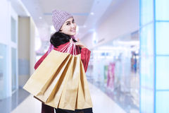 Happy girl in shopping mall Stock Image