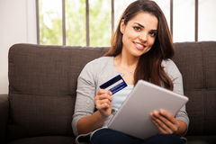 Happy girl shopping online Stock Photography