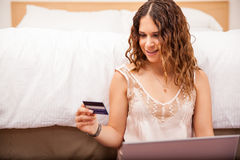 Happy girl shopping online Stock Images