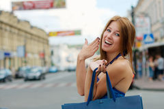 Happy girl shopping outdoors Stock Photos