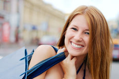 Happy girl shopping on a street Royalty Free Stock Photography