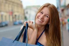 Happy girl shopping on a street Stock Image
