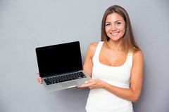 Free Happy Girl Showing Blank Laptop Screen Royalty Free Stock Images - 57305859