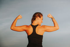 Happy girl showing body strength. Stock Image