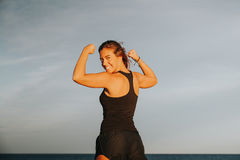 Happy girl showing body strength. Royalty Free Stock Images