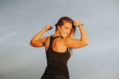 Happy girl showing body strength. Royalty Free Stock Photos