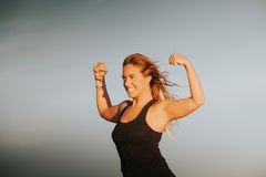 Happy girl showing body strength. Royalty Free Stock Photography