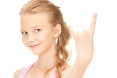 Happy girl showing devil horns gesture Stock Photography