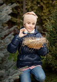 Happy girl showing Easter egg she found on backyard Royalty Free Stock Photo