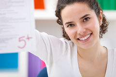 Happy girl showing her perfect  test Stock Image