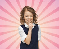 Happy girl showing hush gesture Royalty Free Stock Photo