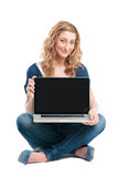 Happy girl showing laptop computer Royalty Free Stock Images