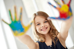Happy girl showing painted hand palms at home Royalty Free Stock Photo