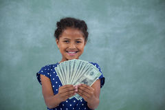 Happy girl showing paper currency Royalty Free Stock Photography