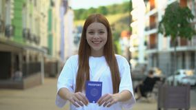 Happy girl showing passport before camera, adulthood, step into adult life. Stock footage stock footage