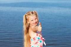 Happy girl showing sign okay with fingers Stock Photo