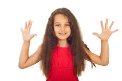 Happy girl showing ten fingers. Happy girl with long curly hair showing ten fingers isolated on white background Royalty Free Stock Photos