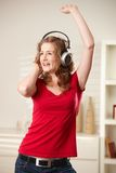 Happy girl singing with headphones Stock Photo