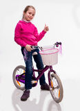 Happy girl sitting on bicycle Royalty Free Stock Photos