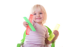 Happy girl sitting with combs Royalty Free Stock Photography