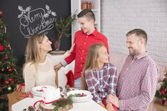 Family meeting at christmas table Stock Image