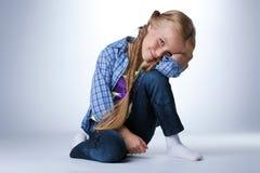 Happy girl sitting on  floor Stock Photos