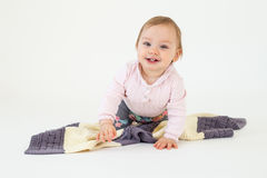 Happy girl sitting on floor with plaid isolated Royalty Free Stock Photos