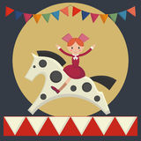 Happy girl sitting on  horse in merry-go-round Royalty Free Stock Photography