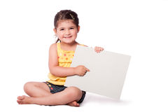 Happy girl sitting pointing at whiteboard stock images