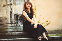 Happy girl sitting on a stairs.  Royalty Free Stock Photo