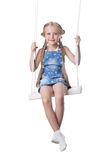 Happy girl sitting on swing Royalty Free Stock Image