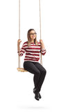 Happy girl sitting on a swing Royalty Free Stock Photography