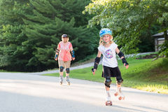 Happy Girl on Skates with Woman in Background Stock Photography