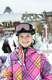 Happy girl in ski helmet at winter resort Stock Photography