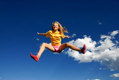 Happy girl in sky Stock Images